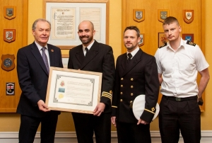 Council Marks Naval Affiliation at Special Ceremony